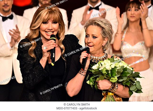 The Italian conductor Milly Carlucci with the president of the jury and dancer Carolyn Smith cry after Carolyn's performance that she danced for the first time...