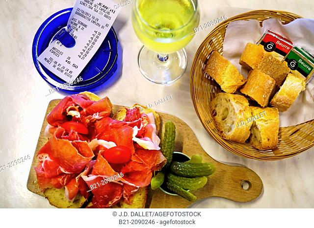 """France. Aquitaine. Gironde. Food and wine: """"""""Jambon du pays"""""""" (cured ham) with """"""""cornichons"""""""" and white wine"""