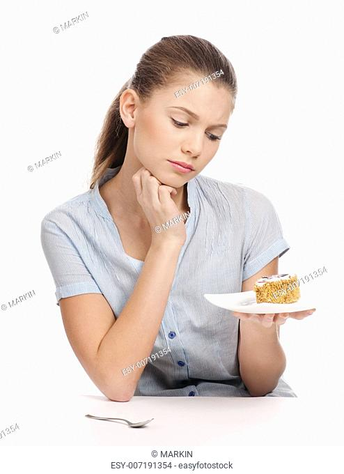 Pretty young woman eating cake. Isolated on the white background