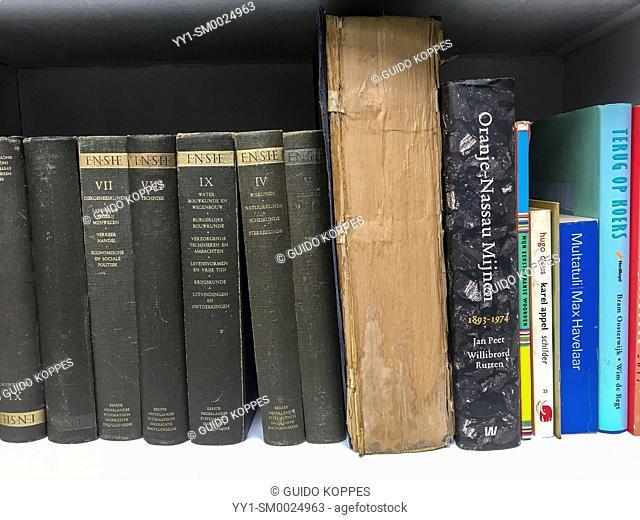 Tilburg, Netherlands. Little vintage libray with retro books inside Duvelhok former textile factory