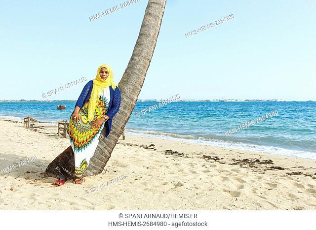 Tanzania, Zanzibar, Chapwani, portrait of a veiled woman by the sea