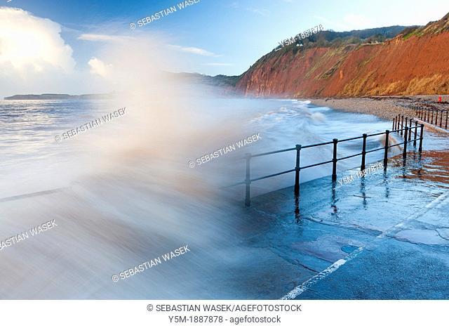 Waves crashing against walkway in Sidmouth, Devon, England, United Kingdom, Europe