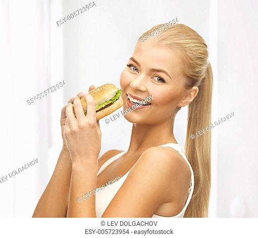 picture of healthy woman eating junk food