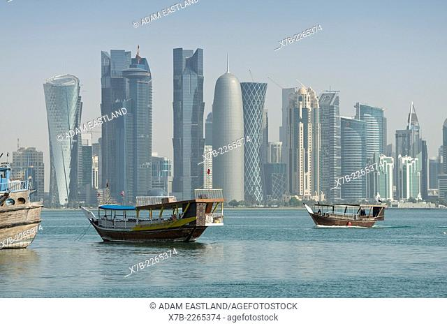 Doha. Qatar. Traditional Dhows & skyscrapers of the West Bay skyline