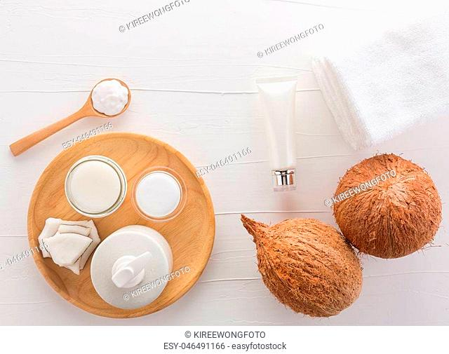 Homemade coconut products on white wooden table background from top view. Good for space and background