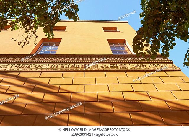 Orange decorative facade of Stadsbibliotek (Stockholm Public Library), designed by Swedish architect Gunnar Asplund (1928), Stockholm, Sweden, Scandinavia