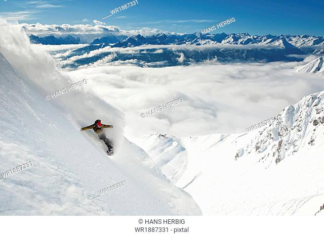 Snowboarder takes a powder turn, Innsbruck, Austria