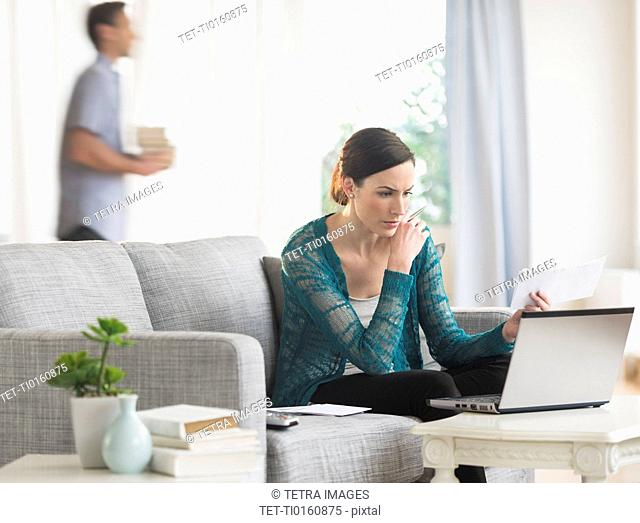 Woman using laptop to pay bills