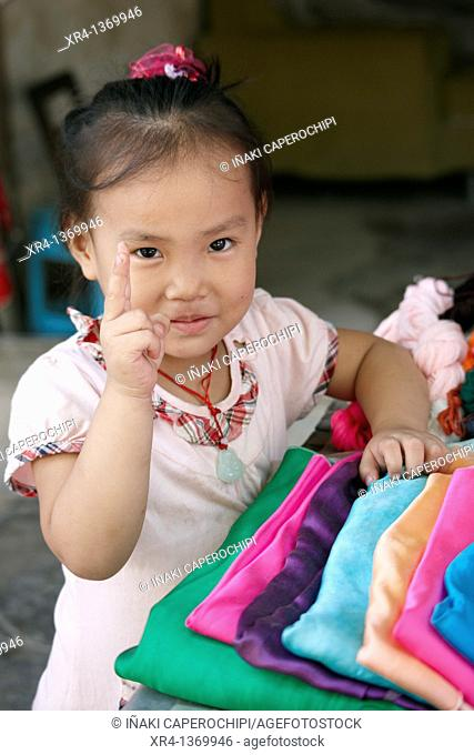 Portrait of a girl in market, Rongjiang, Guizhou, China