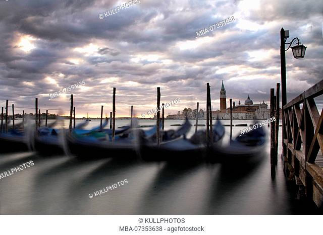 Gondolas in the lagoon of Venice, sunrise, Italy