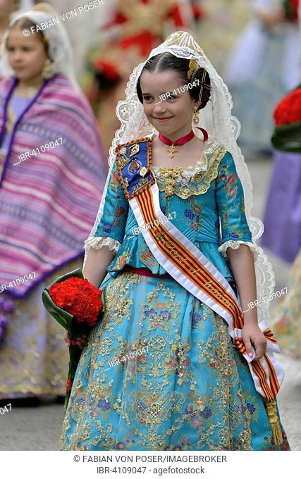 Fallas festival, girl in a traditional costume during the parade in the Plaza de la Virgen de los Desamparados, Valencia, Spain