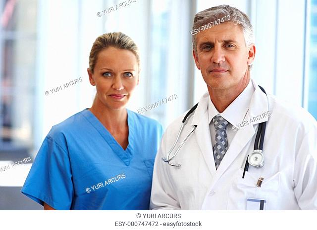Team of relaxed satisfied doctors standing together