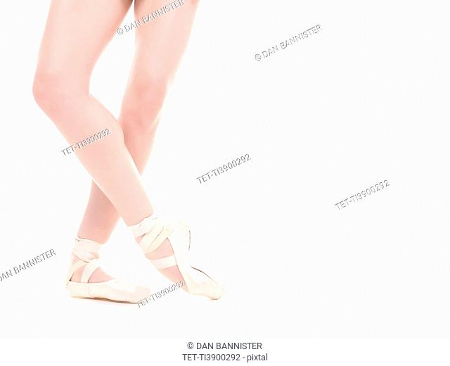 Ballet dancer's legs, studio shot
