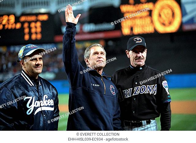 President George W. Bush waves to the World Series crowd at Yankee Stadium. With him are Yankees manager Joe Torre (left) and Diamondbacks manager Bob Brenly