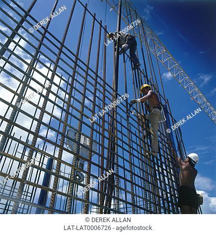 Construction workers on Tsing Ma Bridge concrete reinforcement rods. Blue sky. July 93