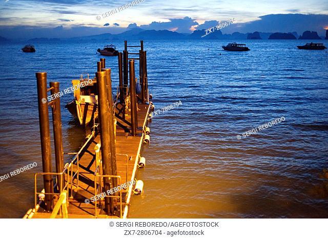 Six Senses Resort, Koh Yao Noi, Phang Nga Bay, Thailand, Asia. Boat in the harbour waiting for Sunrise Picnic breakfast on a deserted Island in Koh Hong...