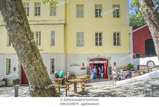 tourists and spa guests in front of o tasco, wine & beer bar, serra de monchique, algarve, portugal