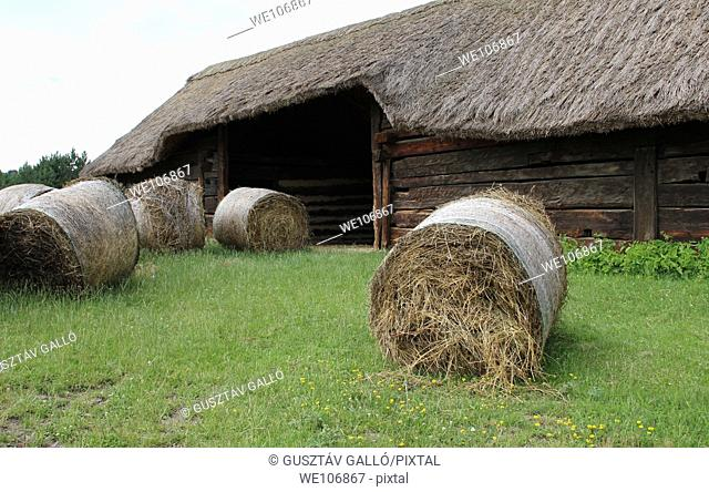 Harvested straw bales in front of the barn, Hungary, Szentendre, Open-air Museum