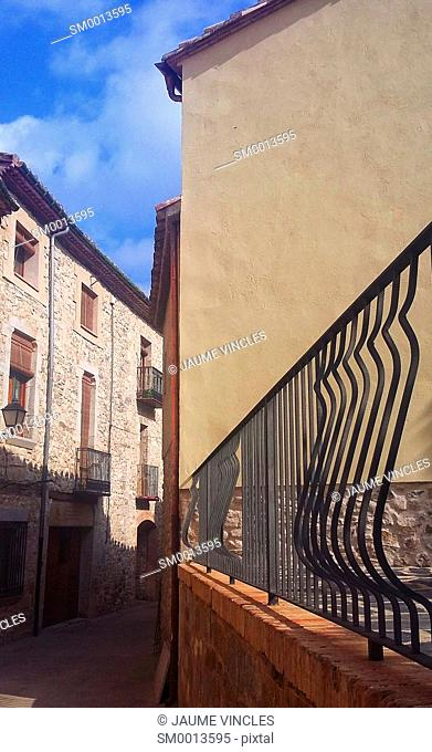 Sensation of depth and twist, in a narrow street of a town of Girona
