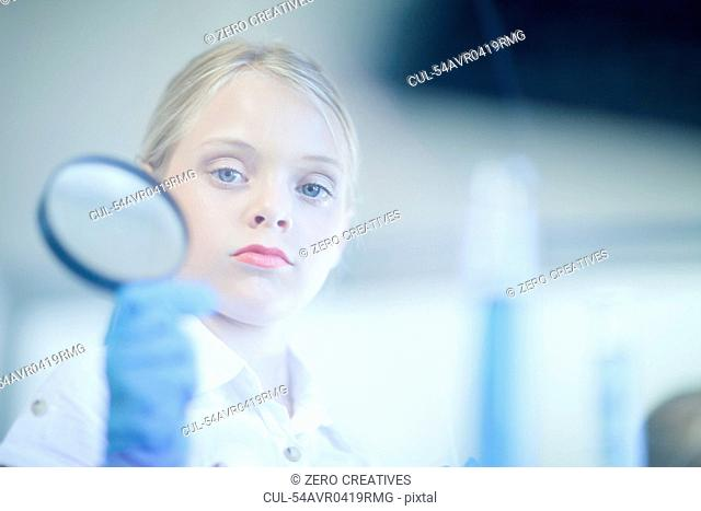 Girl playing scientist in lab