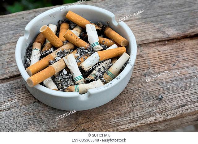 cigarette stub in ashtray, image no smoking concept background