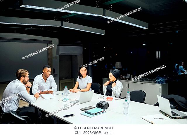 Businessmen and women having conference table meeting