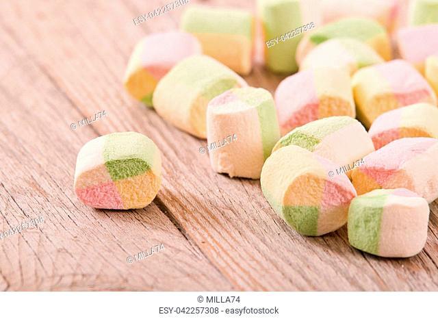 Marshmallows on wooden table