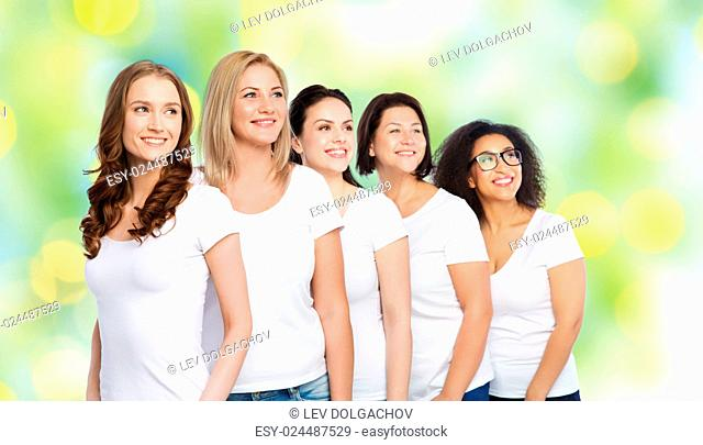 friendship, diverse, body positive and people concept - group of happy different size women in white t-shirts over green holidays lights background
