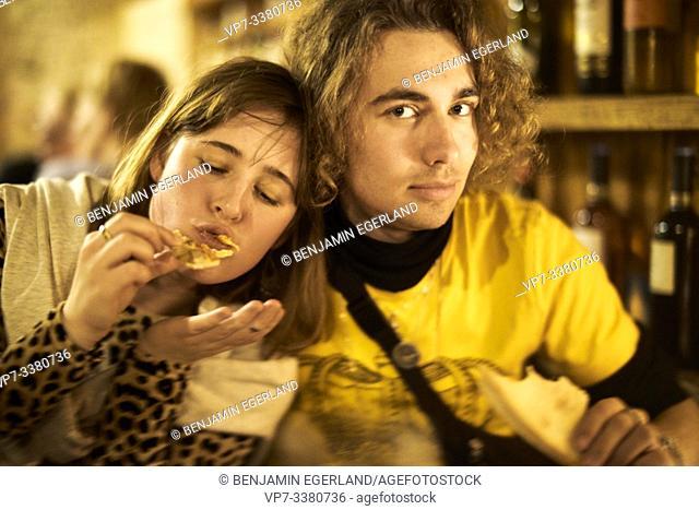 couple enjoying pizza for dinner in Berlin, Germany