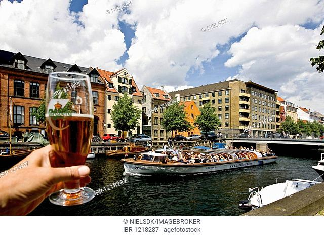 Cheers to the sightseeing boat in Christianshavn canal, Copenhagen, Denmark, Europe