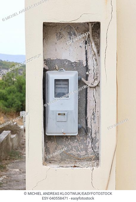 Old electricity meter in a village in Greece