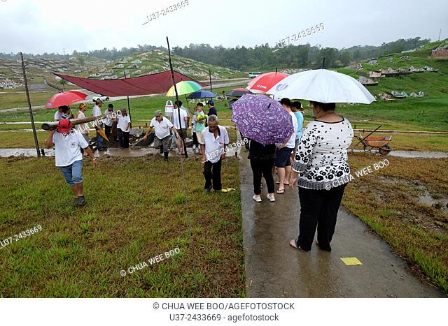 Burial ground at Hakka's Association cemetery, Kota Padawan. Sarawakian chinese funeral ceremony. Malaysia