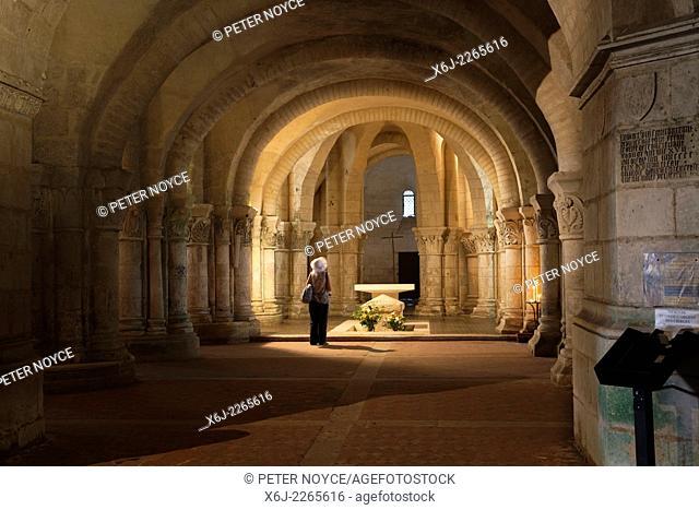 A tourist in the crypt of the Basilica of Saint Eutropius in Saintes