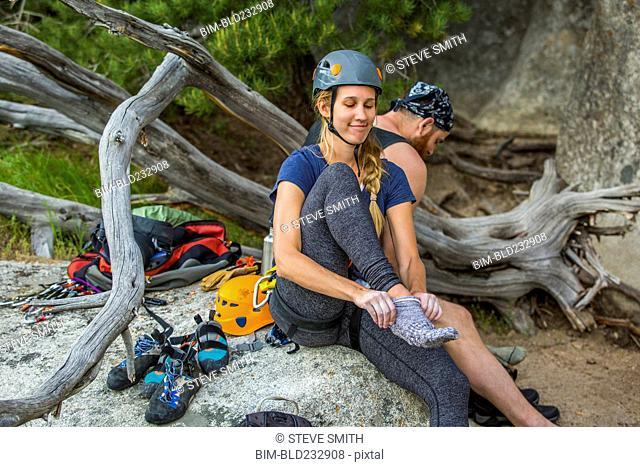 Caucasian rock climber wearing sock
