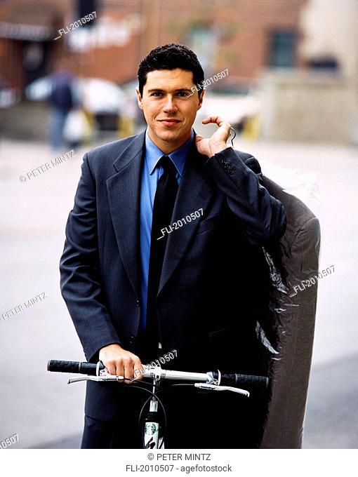 Fv4025, Peter Mintz; Businessman On Bike With Dry Cleaning
