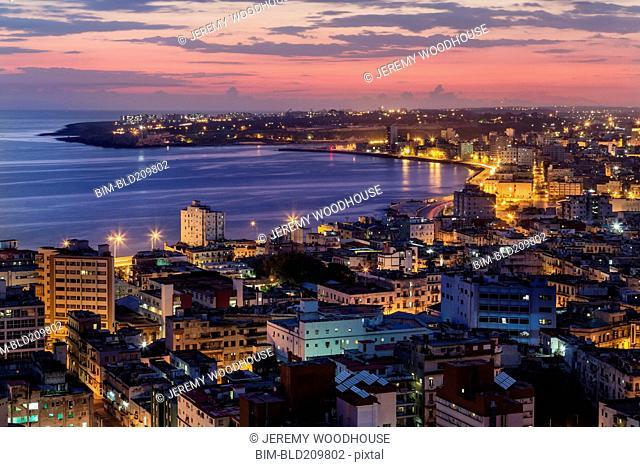 Aerial view of city skyline lit up at sunrise, Havana, Cuba