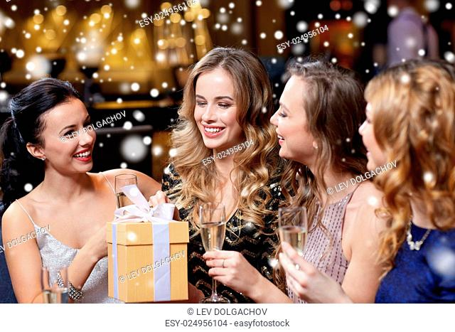 celebration, friends, new year, christmas and winter holidays concept - happy women with champagne glasses and gift box at bachelorette or birthday party at...