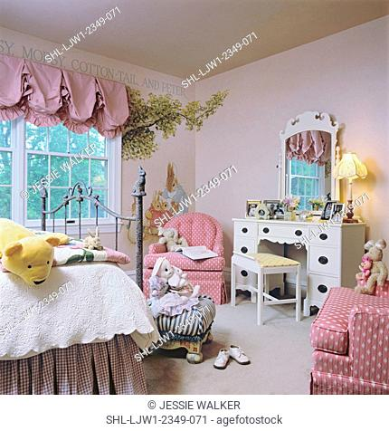 CHILDREN'S BEDROOM: Little girl's room, shades of pink used throughout, white dresser, Peter Rabbit theme, mural painted on walls, view to dresser