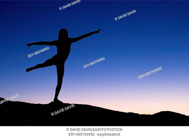 Young woman relaxing with early morning Yoga