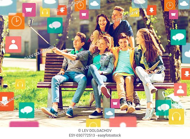 education, technology and people concept - group of happy teenage students or friends taking selfie by smartphone and monopod outdoors with menu icon