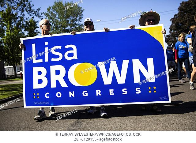 Supporters of Lisa Brown, a Democratic candidate running to represent Washington's 5th Congressional District, march in the annual Frontier Days Parade