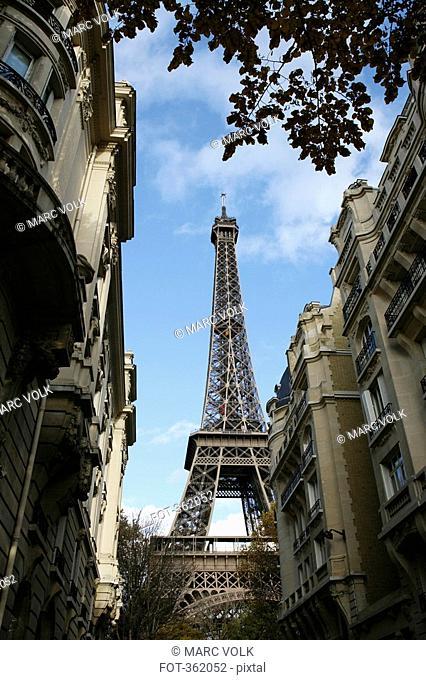 View of Eiffel Tower between residential buildings, Paris, France