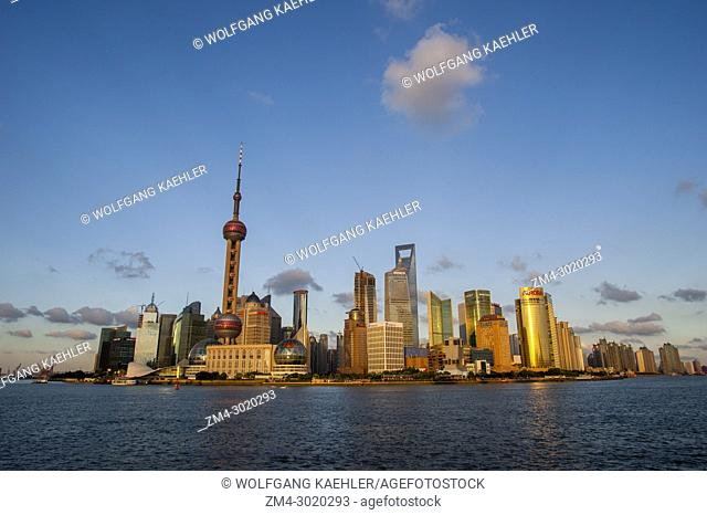 View from the Bund of the Huangpu River, the 492 meter high World Financial Center and the Oriental Pearl Television Tower in Pudong, Shanghai, China