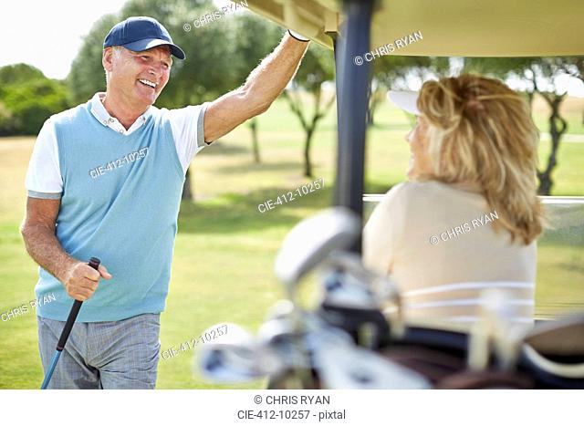 Senior couple in golf cart