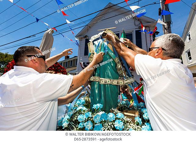 USA, Massachusetts, Cape Ann, Gloucester, St. Peter's Fiesta, Italian-Portuguese fishing community festival, religious procession, money being pinned to St