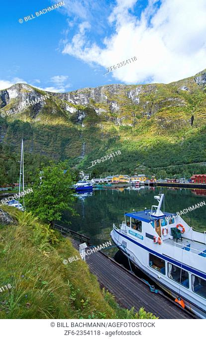 Flam Norway small beautiful village on lake with ferries and boats deep in mountaions at peaceful setting for holiday drive between Oslo an dBergen