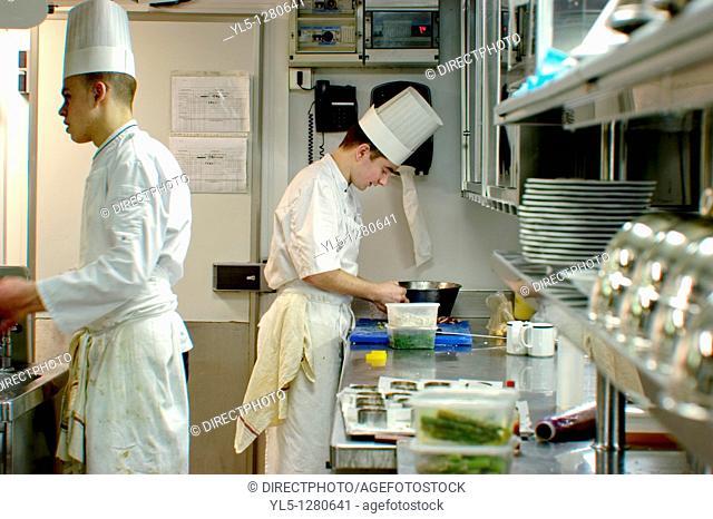 Paris, France, Haute-Cuisine French Cuisine Restaurant in Eiffel Tower, Jules Verne. Chefs Preparing Meals in Kitchen