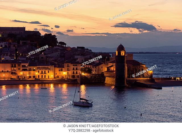 Night view of the town waterfront and bell tower of the Church Notre Dame des Anges, Collioure, Côte Vermeille, Céret, Pyrénées-Orientales, Occitanie, France