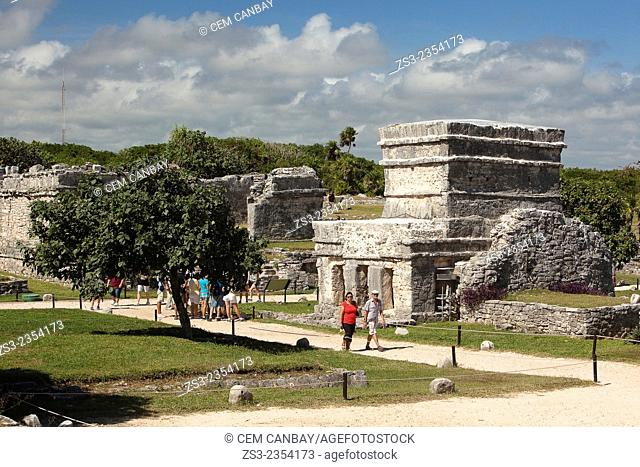 Tourists in Mayan Ruins at Maya archeological site of Tulum, Quintana Roo, Yucatan Province, Mexico, Central America
