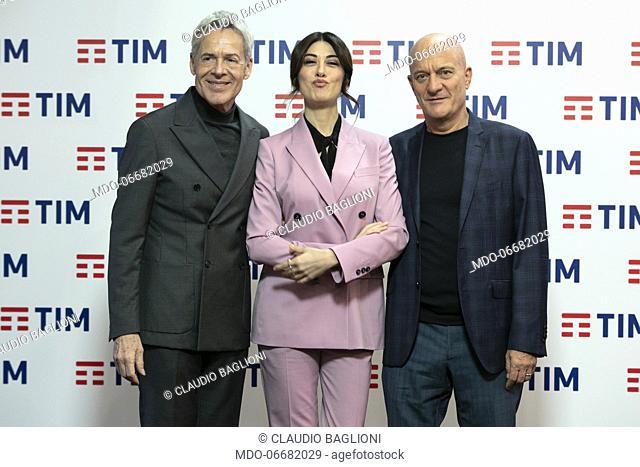 Italian presenters Claudio Baglioni, Claudio Bisio and Virginia Raffaele in the Press Room of the 69th Sanremo Music Festival
